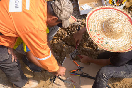 Muadzam Shah, Malaysia - August 19th, 2019 : Electrical engineer technician fixing high voltage underground cable wire installation.