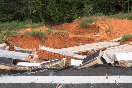 Drain damage. Soil erosion or landslide  in the slope  during  the rainy season at Muadzam Shah, Malaysia. Imagens