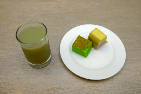 Guava juice in glass and Malay traditional cake  on the white plate served  on a table Stockfoto