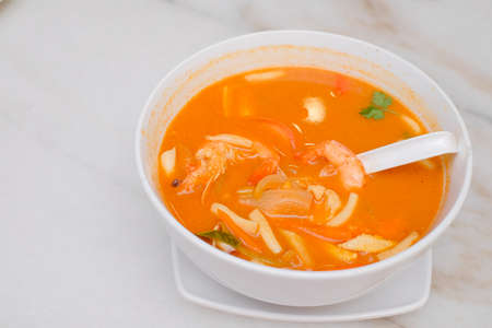 Photo of Seafood Tomyam soup in the white bowl - Thai food