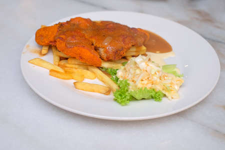 Chicken chop with french fried and vegetable