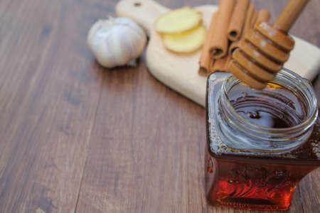 Alternative medicine with Garlic, honey and cinnamon isolated on white background
