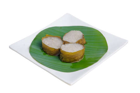 Lemang with banana leave isolated on white background. Popular food for breaking fast during ramadan, Ramadan Food.