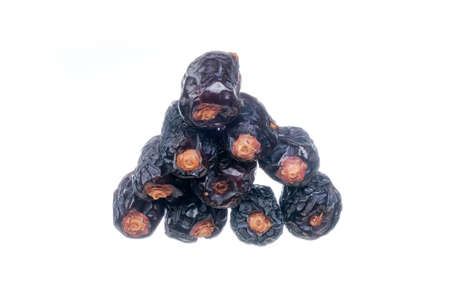 Ajwa Dates or Kurma Ajwa isolated on white background. Prophet dates is one of the special fruit  of Arabic . Stock Photo