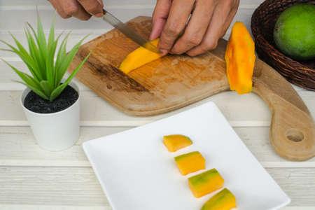 Sliced mango fruit on wooden background. Healthy Food Stok Fotoğraf