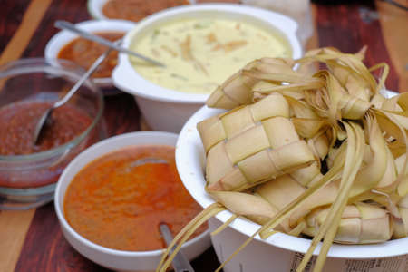 Ketupat, Lodeh and Rendang  . Traditional celebratory dish of rice cake with several side dishes, popularly served during Eid celebrations Stok Fotoğraf
