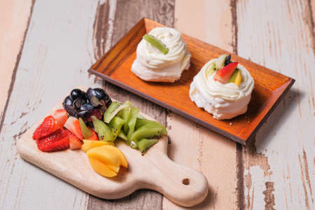 Mini pavlovas with whipped cream and fresh fruit