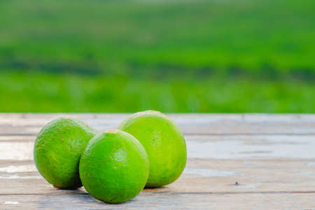 Limes on old wooden with blurred background ,healthy nutrition,strengthening immunity and diet