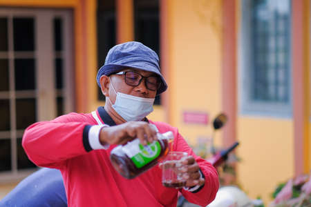Kuala Lumpur-Malaysia - February 5th, 2021 : Disinfectant worker making disinfection in the college  to control an outbreak of coronavirus .