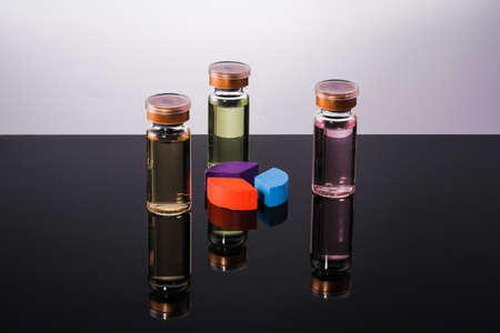 A Vaccine in vial  close-up on a  glass table, medical concept, laboratory, subcutaneous injection vaccination, dose. Disease treatment immunization.