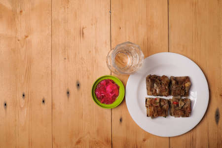 A close up of Murtabak Daging and fresh drinking water with sauce on plate. Famous and delicious food during Ramadan.
