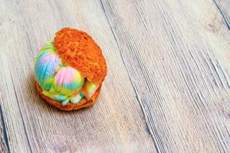 Ice cream puff on wooden background