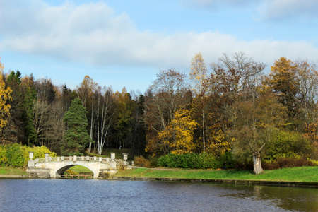 Autumn landscape: park on riverbank