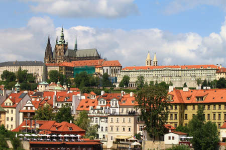 Prague castle cityscape with St.Vitus cathedral from Charles bridge, Czech Republic. Horizontal image photo
