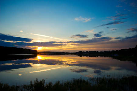 Rural landscape with tranquility sunset over river photo
