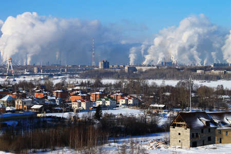 Cityscape with factory smoke in winter photo