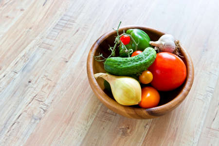 Fresh vegetables in wooden bowl photo