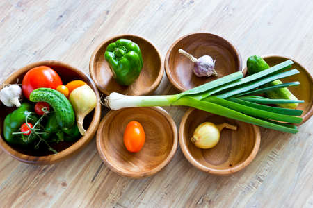 Fresh vegetables in wooden bowls photo