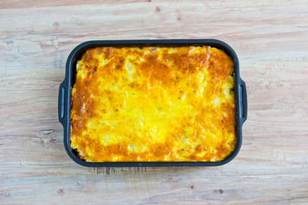 Potato casserole with eggs and meat. Horizontal image photo