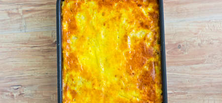 Potato casserole with eggs and meat photo