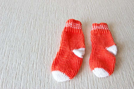 christmas baby: Colorful wool baby socks isolated on white background. Socks at the right part of image