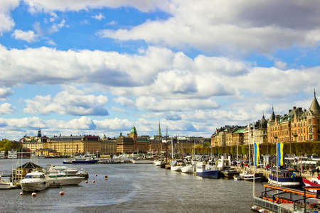 Cityscape of Stockholm embankment with beautiful sky and yachts, Sweden photo