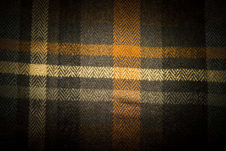 textile image: Abstract textile colorful checkered background. Horizontal image with deep dark vignette Stock Photo