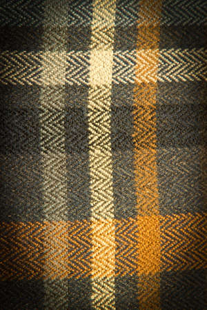textile image: Abstract textile colorful checkered background. Vertical image with dark vignette Stock Photo