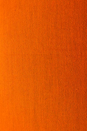 textile image: Abstract textile orange background. Vertical image