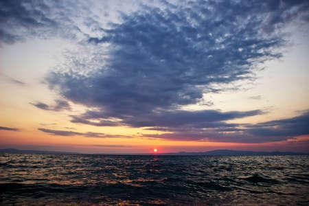 Beautiful sunrise over Aegean sea, Greece photo