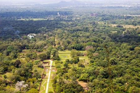 Landscape with mounts and Buddha statue, Sigiriya photo