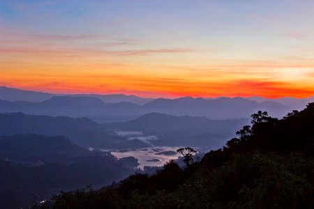 forest river: Beautiful mountain landscape in fog at sunrise. View from Adam peak in Sri Lanka, Ceylon