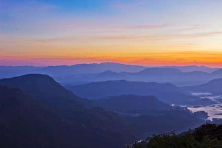 Beautiful mountain landscape in fog at sunrise. View from Adam peak in Sri Lanka, Ceylon photo