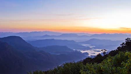 pada: Beautiful mountain landscape in fog at sunrise. View from Adam peak in Sri Lanka, Ceylon