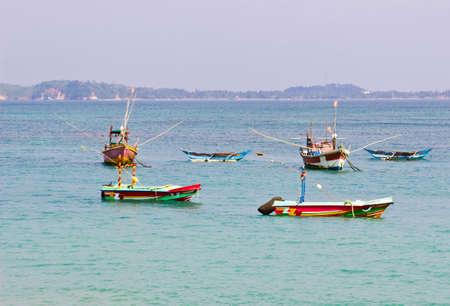 pristine corals: Fishing boats in beautiful ocean near coastline of Sri Lanka, Ceylon