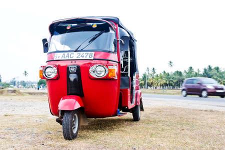 tuktuk: Red empty tuk-tuk waits for passengers. Galle, Sri lanka