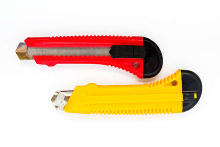boxcutter: Red and yellow construction knife tool on white