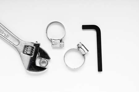 clamps: Pipe clamps with key and spanner isolated on white