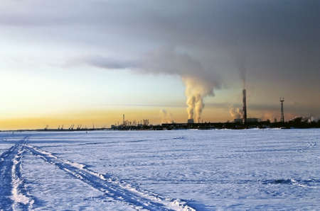 polution: Industrial winter sunset with factory smoke Stock Photo