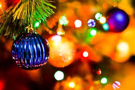 luminosity: Colorful balls on a Christmas tree with luminosity