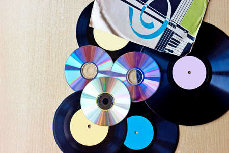 retro backgrounds: Background with Vinyl record discs ans CD. Top view