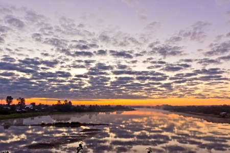 tranquility: Beautiful summer landscape with tranquility sunrise over the foggy river Stock Photo