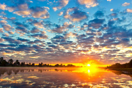 sky reflection: Beautiful summer sunrise with multicolored sky reflection in river