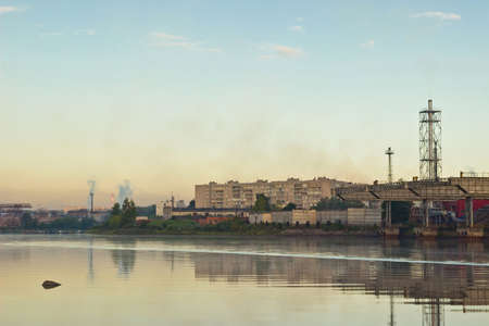 paesaggio industriale: Summer industrial landscape with factory at sunrise Archivio Fotografico