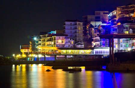 luminosity: night cityscape of small resort town with multicolored luminosity Stock Photo