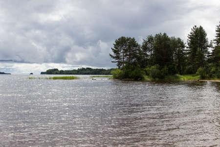 onega: Landscape of Onega lake shore. Rain is coming Stock Photo