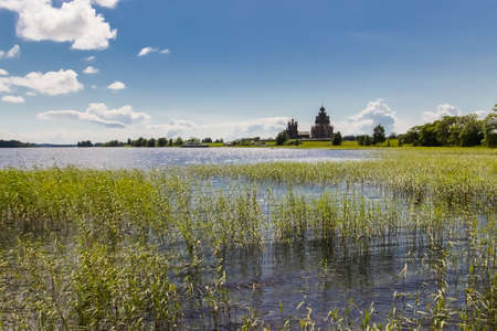 Kizhi pogost on Kizhi Island, view from lake shore, Karelia, Russia. Ancient wooden architecture. Summer landscape