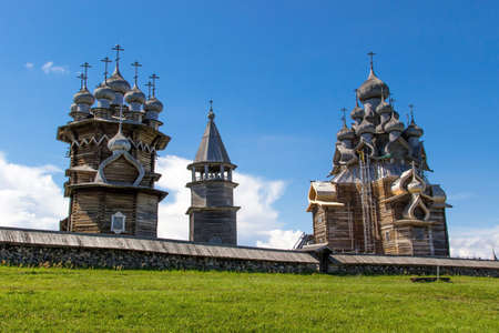 onega: Ancient wooden religious architecture. Summer landscape. Kizhi Island, Russia