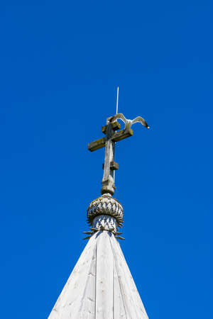 Wooden dome of traditional wooden chapel with seagull on cross, Kizhi island, Russia