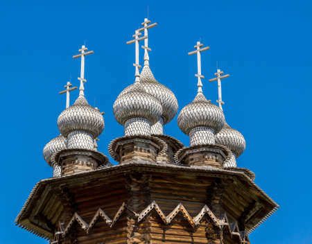 Domes of Church of the Intercession against deep blue sky, Kizhi Island, Russia. Stock Photo